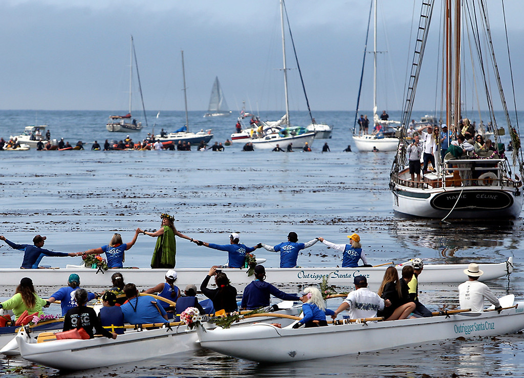 . Leis are placed into the water before a prayer is said for surfing pioneer Jack O\'neill near Pleasure Point in Santa Cruz on Sunday morning during a paddle-out ceremony. (Kevin Johnson -- Santa Cruz Sentinel)