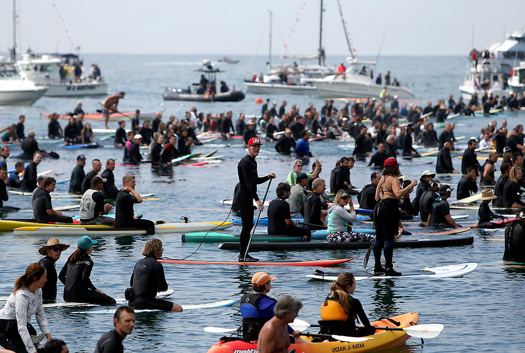 . Thousands took to Monterey Bay near Pleasure Point in Santa Cruz on Sunday morning for a paddle-out ceremony in honor of Jack O\'Neill. (Kevin Johnson -- Santa Cruz Sentinel)