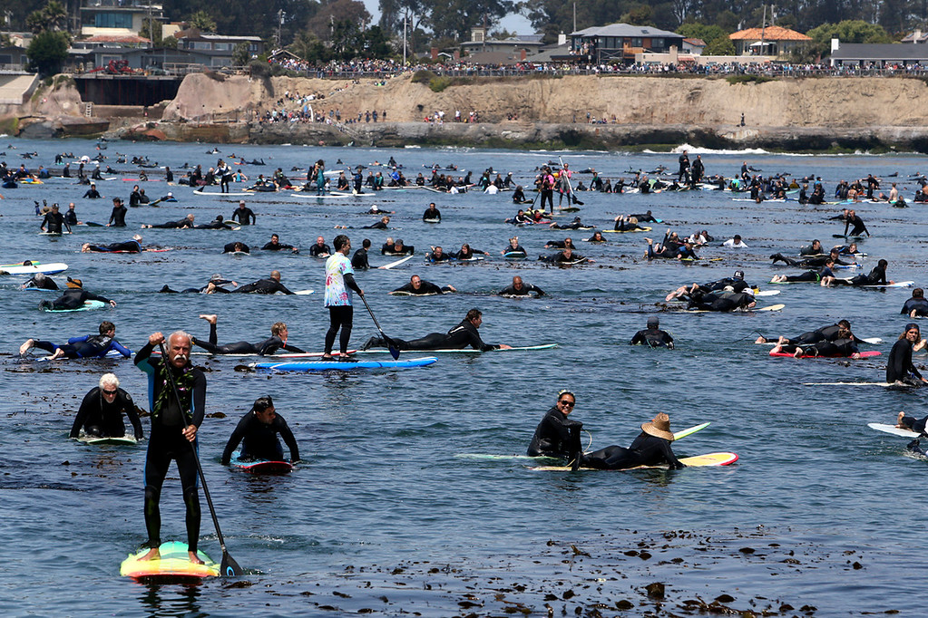 . Thousands paddle through the cold Monterey Bay near Pleasure Point in Santa Cruz on Sunday morning in honor of surfing legend Jack O\'Neill. (Kevin Johnson -- Santa Cruz Sentinel)