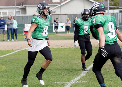 St. Bernard's senior quarterback Jack Rice celebrates with teammate TJ Campbell after he scored a rushing touchdown against Arcata on Sept. 24, 2016, at Crusader Field in Eureka. (Danny Penza - The Times-Standard file)