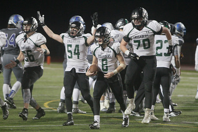 St. Bernard's quarterback Jack Rice, center, celebrates with teammates after the Crusaders won the CIF Division V-A state title with a 28-21 win over Saddleback Valley Christian on Dec. 19, 2015. (Danny Penza - The Times-Standard file)