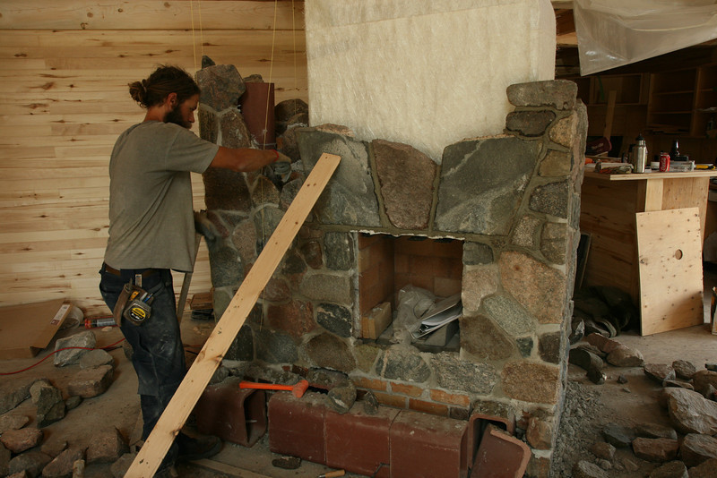 Matt building a fireplace