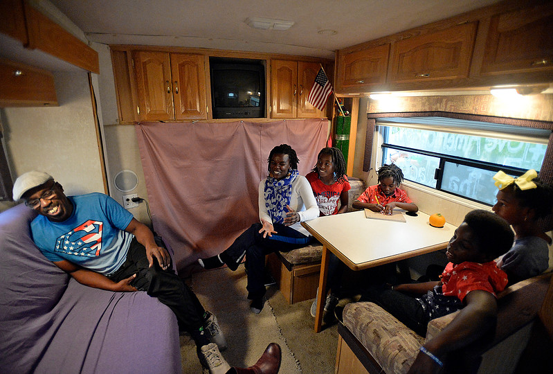 "Sitting in an RV west of Loveland, the Jackson family reminisce Monday, Oct 2, 2017, about their adventures while traveling the United States on their ""Love America Tour"". Clockwise from left are Alan ""Pops"" Jackson, Casaundra Jackson, K'rah Jackson, 16, R'san Jackson, 7, Kyilah Jackson, 13, and K'shan Jackson, 11. The Texas family is visiting the Loveland area as part of its journey to take their children to all 50 U.S. states via bus or train. All that is left are Hawaii and Alaska for the home school family.  <br /> (Photo by Jenny Sparks/Loveland Reporter-Herald)"