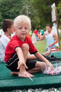 2014 Shrimp Festival Boy Tosses Candy