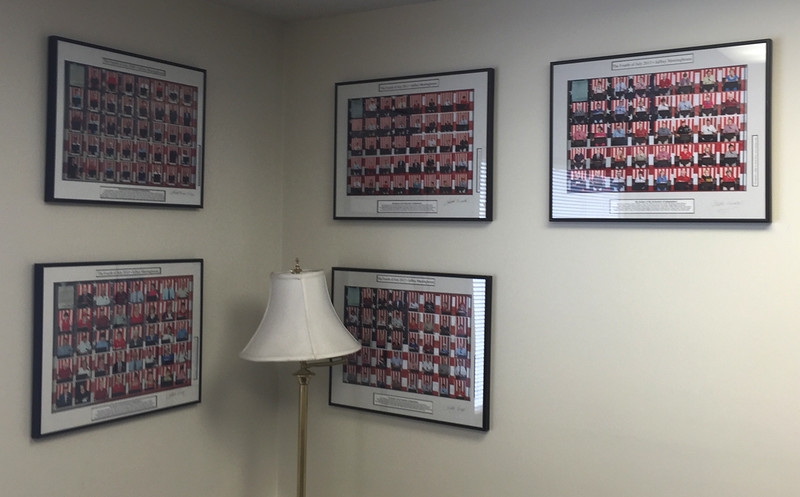 Framed photographs of annual readers of the Declaration on the second floor of the Town Offices. Photographs by Chuck Bruce.