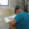 Walt Hautanen painting the Horseshed signs. July 20, 2011.