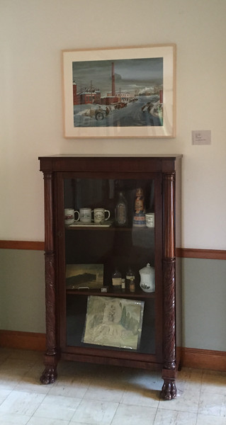 Newly rejuvenated (2015) display case on the ground floor of the Civic Center above which hangs the recently donated Gouri Ivanov-Rivov 1946 painting of downtown Jaffrey in winter.