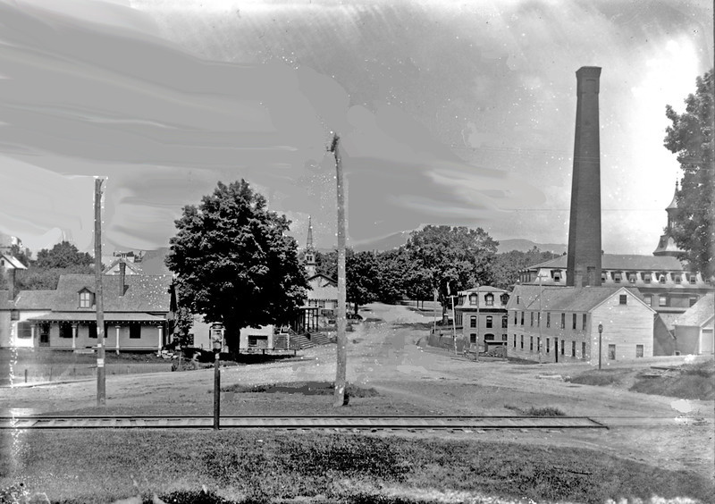 001. Looking west up Main Street with te Jaffrey Mills on the right and the railroad in the foreground. Date: 1893