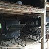 Two historic hearses—wheeled and sleigh—in the Barrett House barn, New Ipswich, 2015.