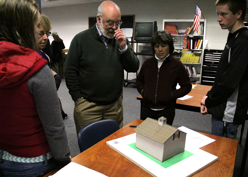 Students present their plans and models to members of the Historical Society.