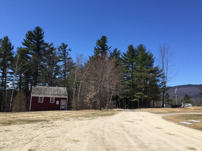 Little Red Schoolhouse on left with proposed site on the right to left of gate, April 15, 2015.
