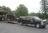 The  wheeled hearse traveling from Cournoyer Funeral Home to the Belletete warehouse in Squantum, September 3, 2013.