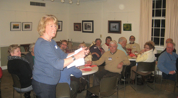 Jackie Johnson describing table artifacts from the Society's collections. A bullet mold. Winter Potluck. February 15, 2015.