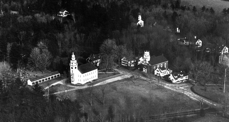 Photo submitted with LCHIP application, June 2020. View looking northeast, with the Meetinghouse, Horsesheds, Old Burying Ground, Little Red Schoolhouse, Cutter Tavern, First Church, Thorndike Store, The Common, Cutter Park and Melville Academy comprising the ensemble—the original heart of Jaffrey. (1980)