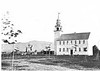 Photo submitted with LCHIP application, June 2020. Possibly the earliest extant photograph of the Meetinghouse, prior to its conversion to Town Offices and High School. The Horsesheds and a Hearse House appear at the rear left with Mt. Monadnock beyond. The Town Clock (1906) had yet to be installed.. (ca. 1865; photographer unknown)