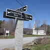 Signpost at the junction of Gilmore Pond Road and Main Street, April 15, 2016.