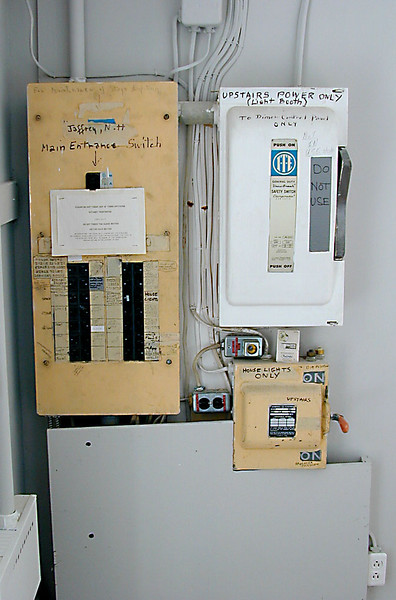 Previously electric panel, since replaced. The only portion remaining is the box in the lower right which operates the chandeliers.