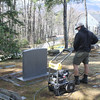 Alex Kaufhold powerwashing Willa Cather's gravestone, April 29, 2016.