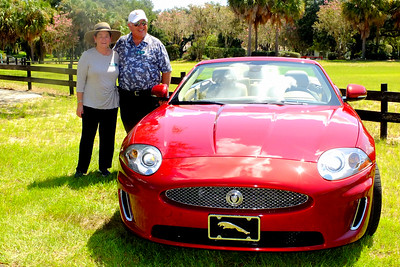 Proud owners, Genie & Juan Sierra and their 2011 Jaguar XK convertible. www.PhotosByDelmar.Net