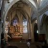 Die erste Stiftskirche brannte 1006 ab. Dieses Schicksal erlitt auch der zweite Bau  im Jahr 1423. 1464 bis 1509 wurde die aktuelle spätgotische Basilika errichtet und 1624 um zwei Kapellen erweitert. Der Turm erhielt 1711 seine aktuelle Gestalt. Der 1515 vom Hallstätter Meister geschaffene Flügelaltar steht erst seit 1853 hier. In diesem Jahr erfolgte ein Altartausch zwischen der Nonnbergkirche und der Pfarrkirche St. Ulrich in Scheffau, einer Filialkirche von Nonnberg. Beim Altartausch behielt man den hölzernen hl. Ulrich als Namenspatron der Kirche in Scheffau zurück und ersetzte ihn durch eine neu geschnitzte Maria mit dem Kinde. Maria wird von den Heiligen Rupert und Virgil flankiert.