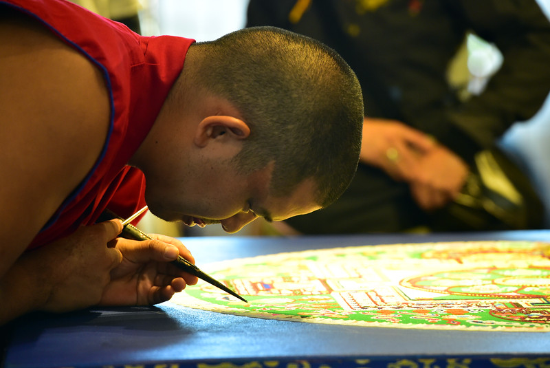 Van. Shanu of the Gaden Shartse Monks works to create a sand mandala at the Jaipur Literature Festival at the Boulder Library Main Branch on Saturday. For more photos go to dailycamera.com  Paul Aiken Staff Photographer Sept 16 2017