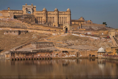 The criss crossed pathways that lead up to Amer fort, built in yellow sandstone surrounded by a network of water bodies in Jaipur, Rajasthan.