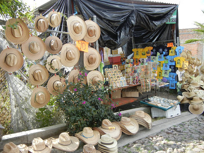 Vendors Sell Hats And Water Along The Long Walkway