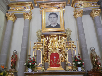 The Altar With A Photo Of The Namesake Priest