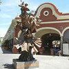 A Sculpture In Front Of El Parian, A Complex Of Cantinas, Garden And The Center For Mariachi Music