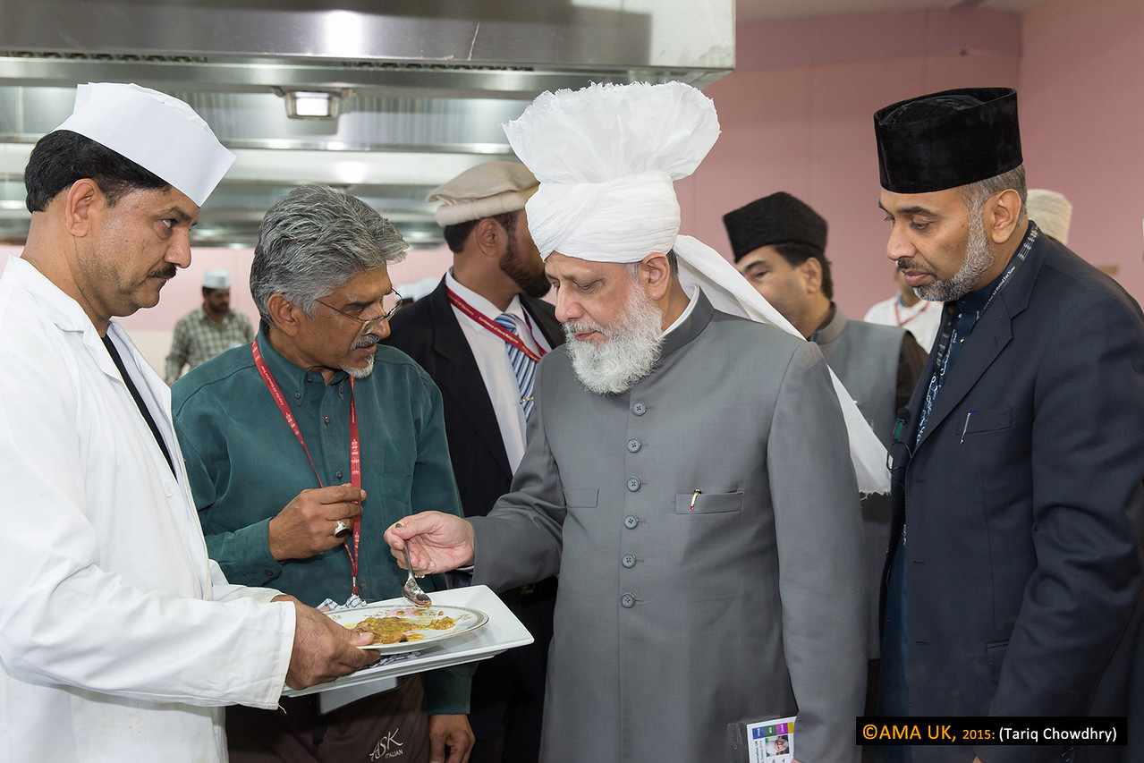 Huzur checking and sampling the food in preparation