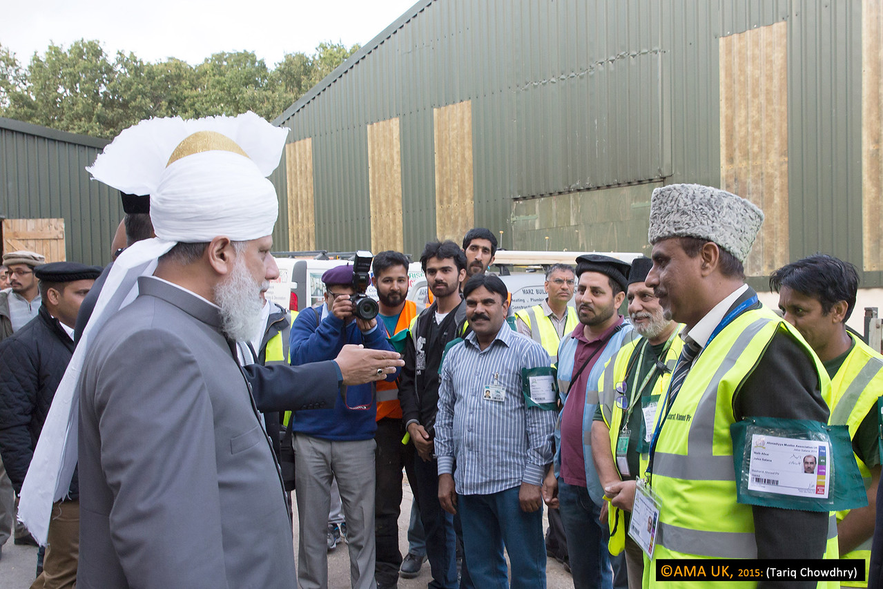 Huzur inspecting and meeting some of the hundreds of volunteers