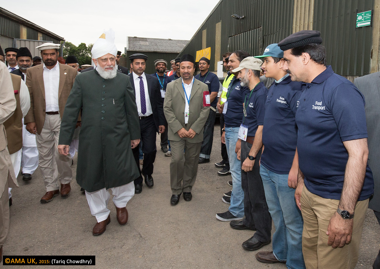 Huzur on inspection tour and meeting some of volunteer workers