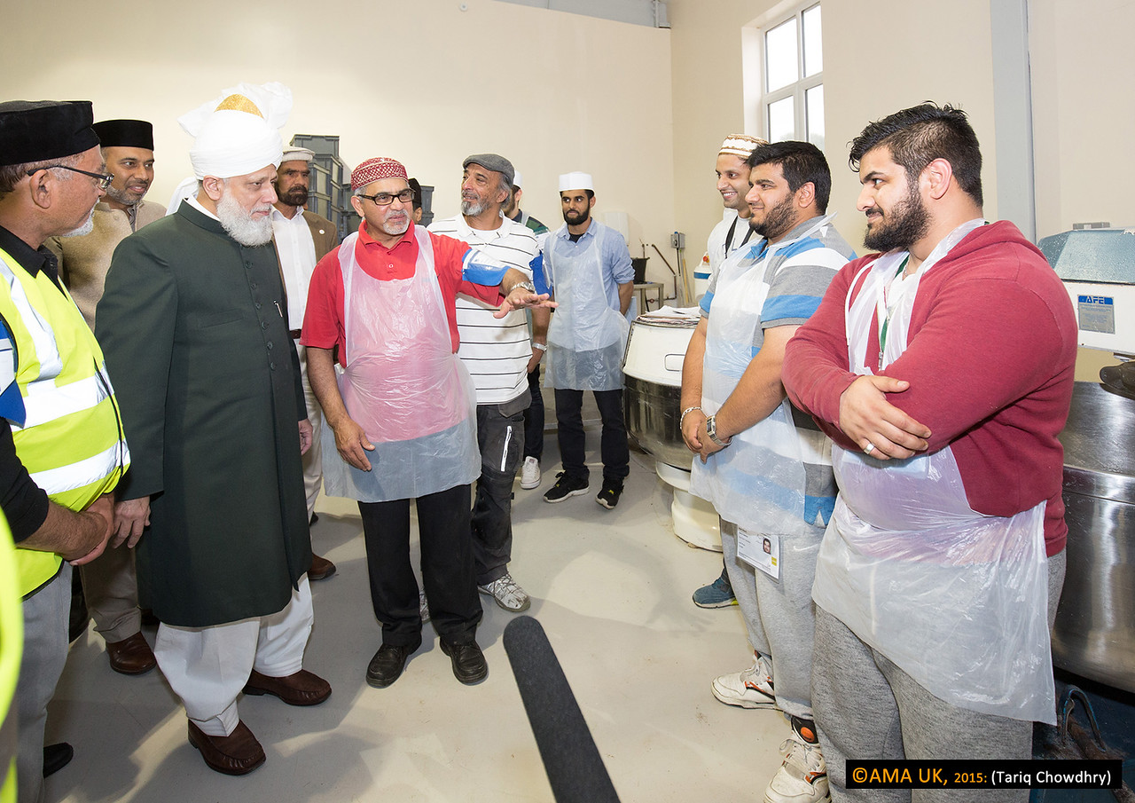Huzur on inspection tour and meeting some of volunteer workers.