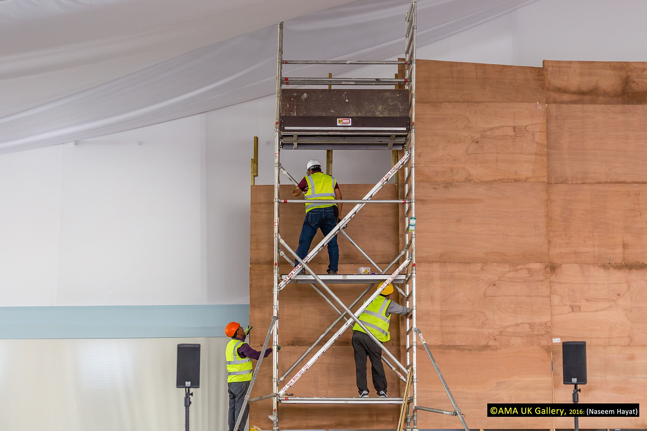 Workers setting up the stage design.