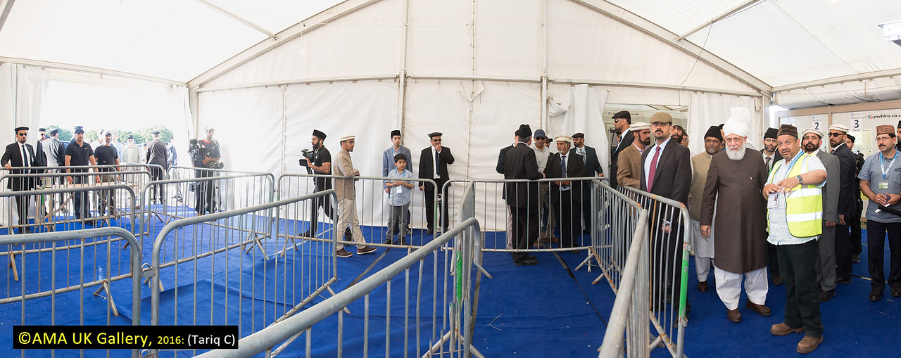 During the inspection, Hazrat Mirza Masroor Ahmad visited the various departments tasked with organising and running the three-day event. His Holiness was briefed on the arrangements as he inspected the site. The entrance and registration section.