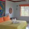 Couples Negril Suite - Beachfront - Sitting area, Extra large bathroom with jacuzzi tub and double sinks, balcony or patio with hammock.<br /> <br /> For more inforation on Couples Negril or any of the Couples resorts, please contact Romance@SandnSunvacations.com