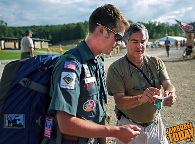 C.J. Rauch, an Eagle Scout from Caldwell, New Jeresy and working at the APO Exhibit, getting some directions to his tent in Echo Staff Camp, from a follow Staff Member, upon his arrive on Saturday July 13, 2013 to the Summit. (BSA photo by Trey Spivey)