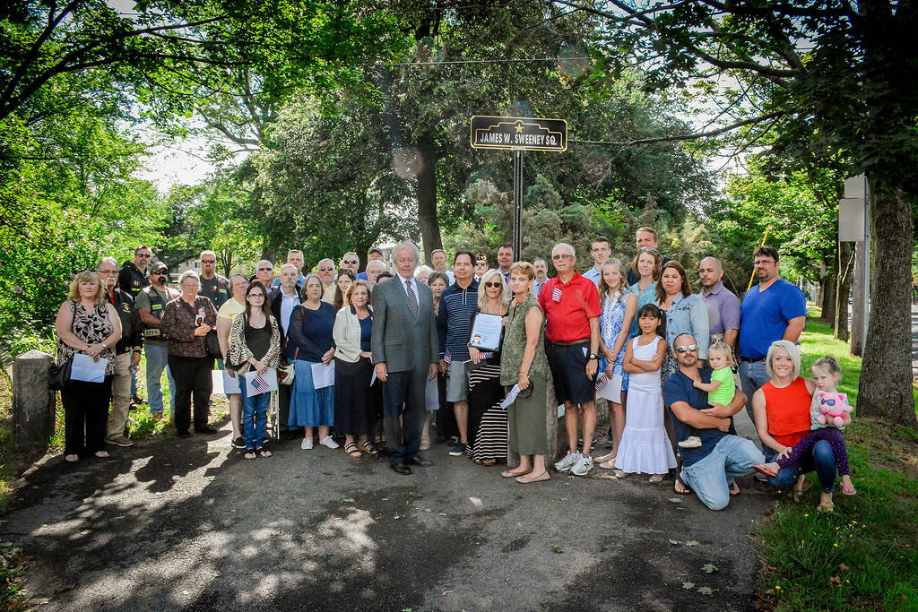 . A group photo of those who attended the dedication for James Sweeney. SUN/Caley McGuane