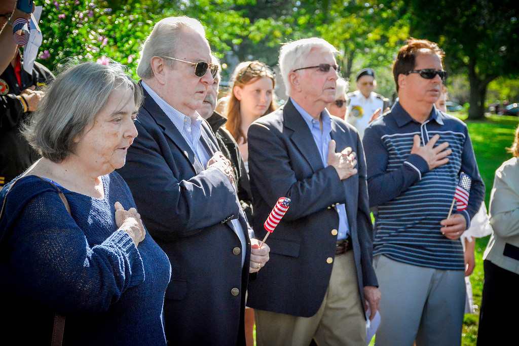 . Guest attending the dedication for James Sweeney place their hands over theire hearts as they recite the Pledge of Allegiance. SUN/Caley McGuane