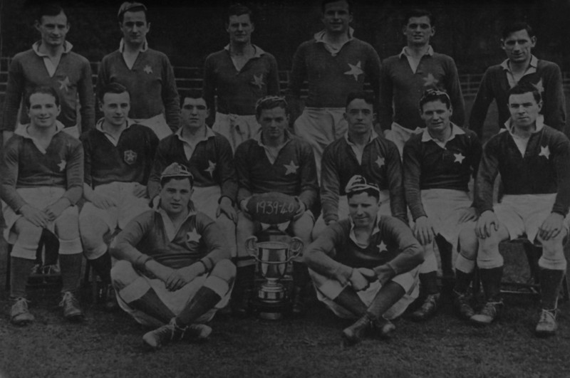 St. Mary s R.F.C.<br /> <br /> Trophy: Metropolitan Cup (J1)<br /> <br /> Captain: D. Smyth<br /> <br /> Players: Back Row: M. Collison, A. Norton, C. Mangan, J. Quigley, J. Ganter, L. Ganter<br /> Middle Row: J. Walker, I. Bergin, I. Boyce, D. Smyth, I. Kelly, B. Arigho, J. Meany<br /> Front Row: P. Meehan, P. Branagan