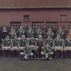 Irish Rugby Football Union<br /> <br /> Description: Ireland v Scotland<br /> 20th March 1976.<br /> <br /> Trophy: n/a<br /> <br /> President: D. Higgins<br /> <br /> Captain: T. Grace<br /> <br /> Players: Back Row: J. West, S. McKinney, M. Keane, W. Duggan, R. Hakin, P. Orr, J. Brady, M.S. Lewis<br /> Middle Row: L. Moloney, J. Cantrell, T. Grace, D. Higgins, S. Deering, P. O Callaghan, S. Blake-Knox<br /> Front Row: B. McGann, J. Moloney