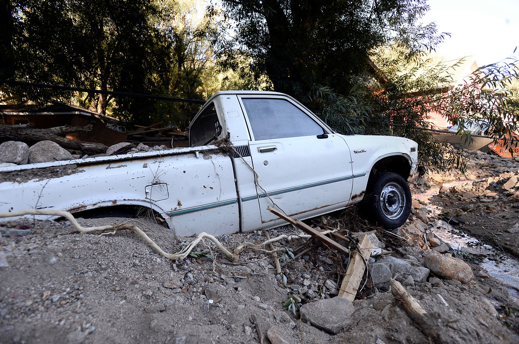 . A truck is buried in debris after the flood in Jamestown on Saturday, Sept. 28. For more photos and a video interview with Senator Mark Udall and residents of Jamestown go to www.dailycamera.com Jeremy Papasso/ Camera