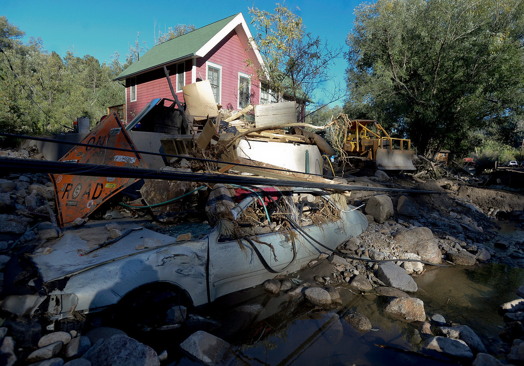 . A destroyed car sits in the water and debris after the flood in Jamestown on Saturday, Sept. 28. For more photos and a video interview with Senator Mark Udall and residents of Jamestown go to www.dailycamera.com Jeremy Papasso/ Camera