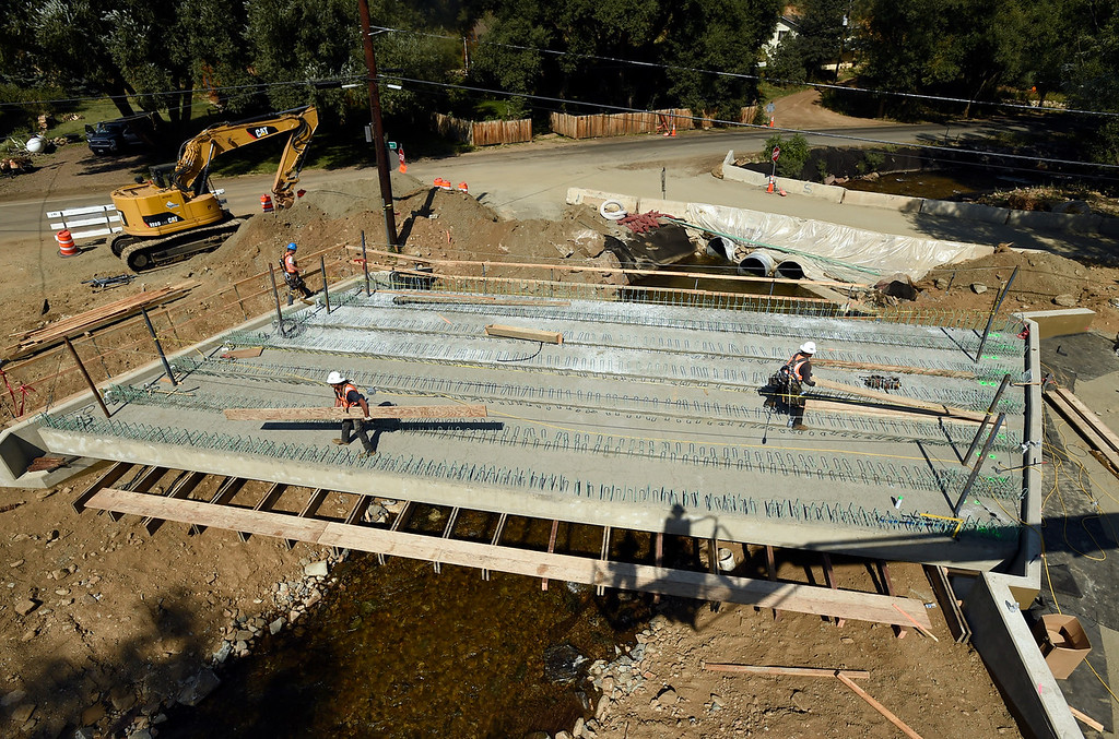 . A SEMA Construction crew works to build a new bridge on Thursday in Jamestown. For more photos of flood repair work and local activity go to dailycamera.com Jeremy Papasso/ Staff Photographer 8/09/18