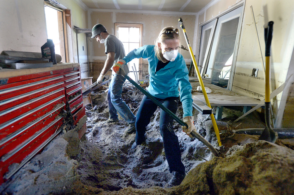 . Donate Boulder volunteers Addy Sage, at right, and Theo Merrin work to remove mud and sand from a home in Jamestown on Saturday, Sept. 28. For more photos and a video interview with Senator Mark Udall and residents of Jamestown go to www.dailycamera.com Jeremy Papasso/ Camera