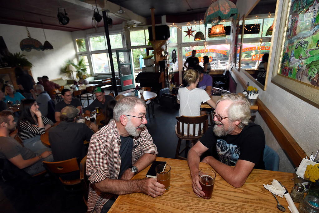 . Jamestown residents Jim McGinley, left, and Ray Buland share a laugh while drinking a beer at the Jamestown Mercantile Cafe on Thursday in Jamestown. For more photos of flood repair work and local activity go to dailycamera.com Jeremy Papasso/ Staff Photographer 8/09/18
