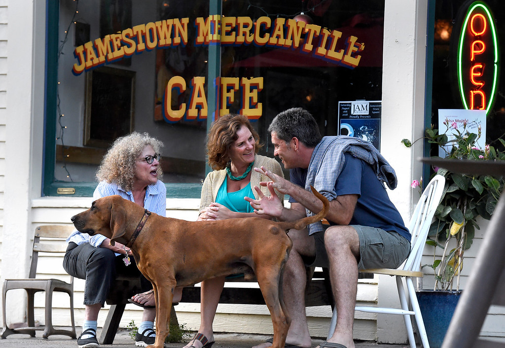 . Jamestown resident Lynne Buland, left, talks with Elizabeth Plum and Rich Kane outside of the Jamestown Mercantile Cafe on Thursday in Jamestown. For more photos of flood repair work and local activity go to dailycamera.com Jeremy Papasso/ Staff Photographer 8/09/18