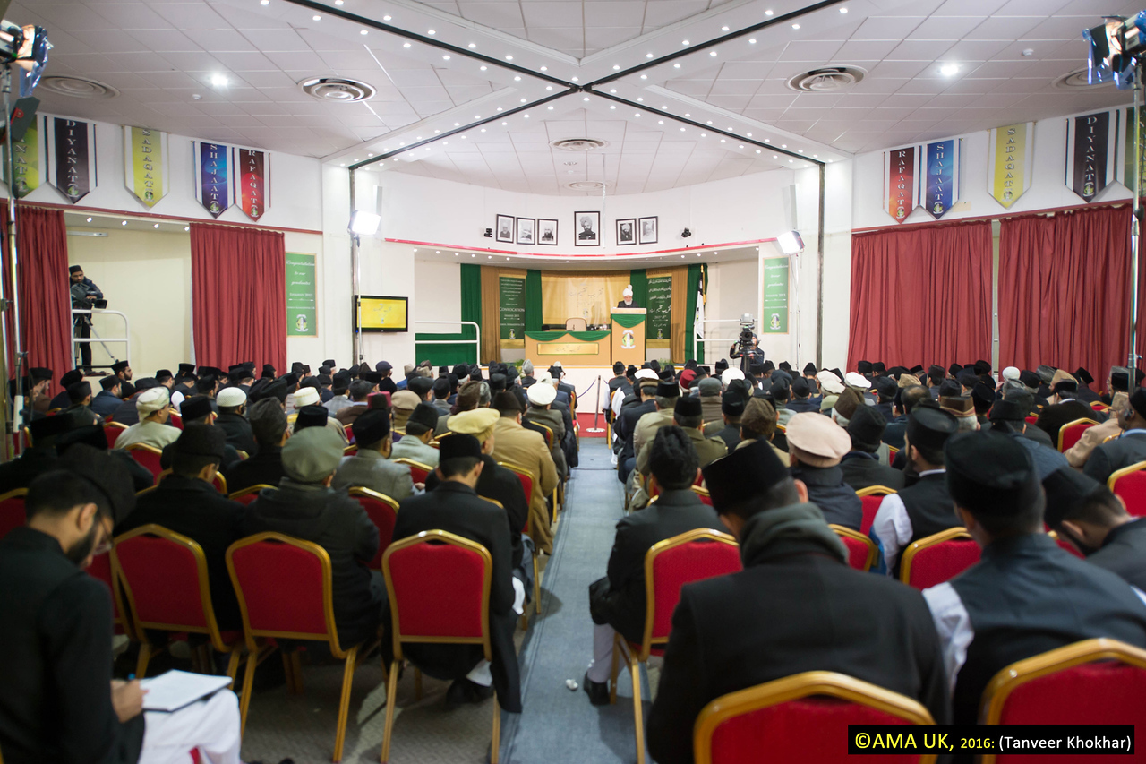 Before the address by the Khalifa: During the ceremony, 17 graduates from Jamia Ahmadiyya UK and 8 graduates from Jamia Ahmadiyya Canada were presented with their 'Shahid Degree' certificates by Hazrat Mirza Masroor Ahmad and were thus enrolled as official Missionaries and Imams of the Ahmadiyya Muslim Community.