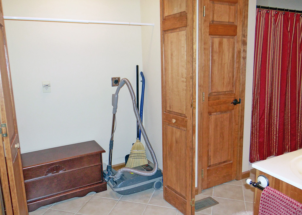 Laundry area in the main floor bathroom can still be used if you wish to have a washer and dryer on the main floor.  Right now we just use it as a coat closet and to store the vacuum and broom.