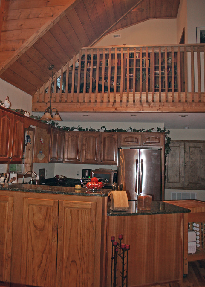 A view of the kitchen and loft outside the master bedroom.  Notice the cabinets in the foreground.